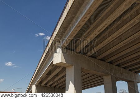 Underside Of A Concrete Modern Bridge And A Blue Sky Background