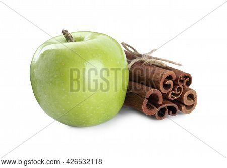 Cinnamon Sticks And Green Apple On White Background
