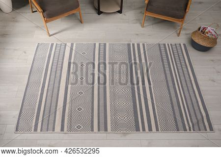 Stylish Rug With Pattern On Floor In Room, Above View