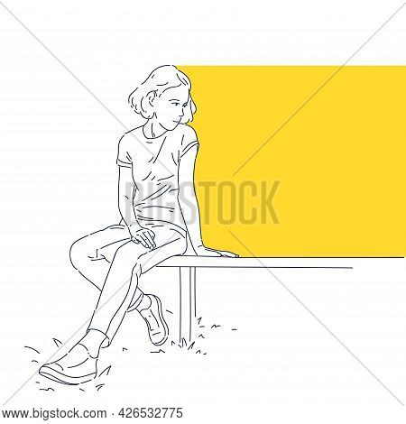 The Girl Is Sitting On A Bench. A Template For Placing Information. A Young Girl In Modern Street Cl