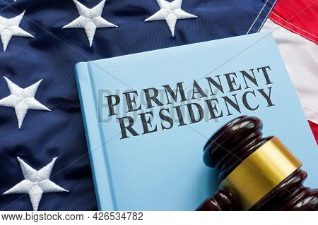 Permanent Residency Law Book On The Flag.