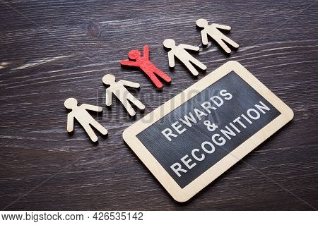 Plate With Rewards And Recognition Words And Wooden Employee Figures.