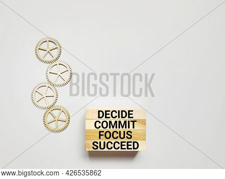 Inspirational And Motivational Concept - Decide Commit Focus Succeed Text Background. Stock Photo.
