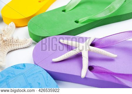 A Few Rubber Beach Flop Flops And Starfish, Use As A Background