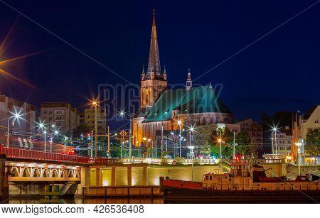 Szczecin. City Embankment In The Night Illumination.