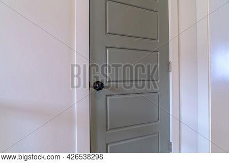 Home Interior With Close Up View Of The Gray Bedroom Door With Black Door Knob