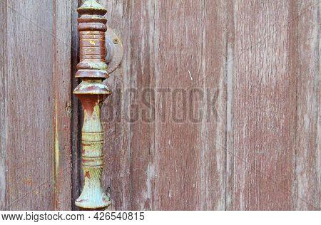 A Handle On An Old Wooden Door, A Long-handled Street Door.