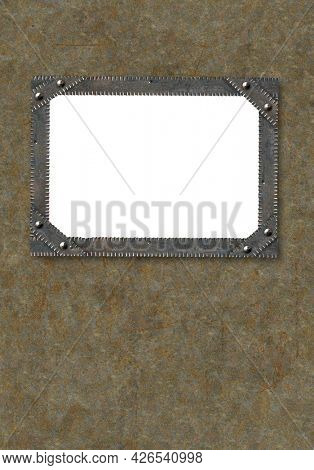 Vertical grunge background in steampunk style. Texture of old metal with rivets and rusty frame. Mock up tempalte. Copy space for your text