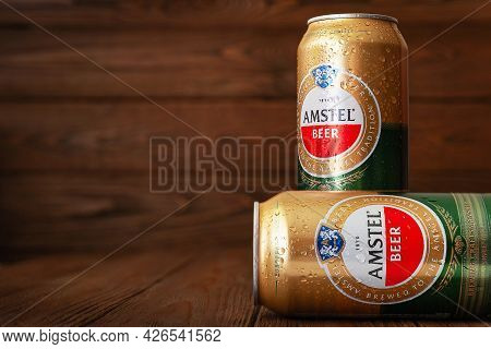 Beer Cans With Water Drops. Amstel Beer In Cans Covered With Condensation. World Famous Dutch Brand.