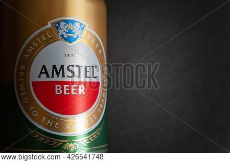 Beer Can. Amstel Beer Close-up On A Black Background With Copy Space. An Internationally Renowned Br