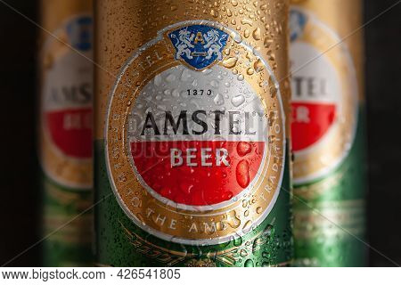 Beer Cans With Water Drops. Amstel Beer Close-up In Wet Cans On A Black Background. An International
