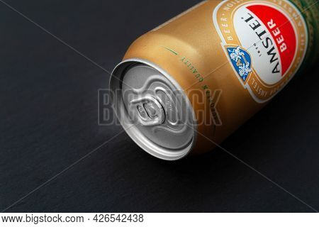 Beer Can. Amstel Beer In A Can Close-up On A Black Background. An Internationally Renowned Brand Fro