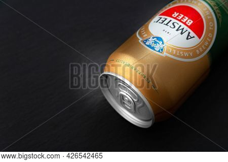 Beer Can. Amstel Beer In Can Close-up On A Black Background With Copy Space. Internationally Renowne