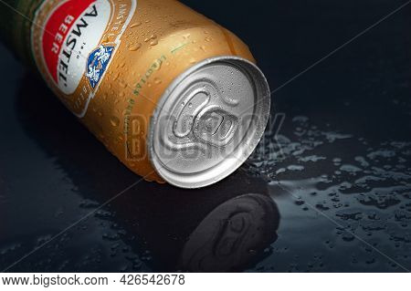 Beer Can With Water Drops. Close-up Amstel Beer In A Can Covered With Condensation. World Famous Dut