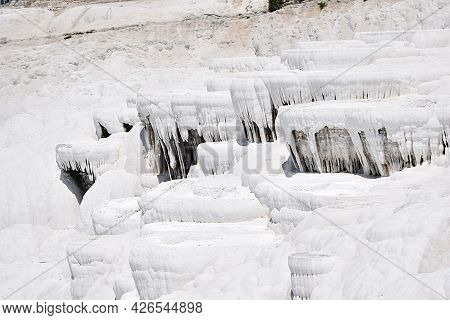 Cascades And Stalactids Formed By Travertine On The Mountainside. Pamukkale