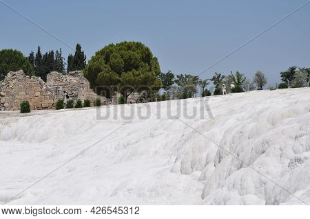 The Mountainside Covered With Travertine And The Ancient Structure Of Hierapolis. Pamukkale.