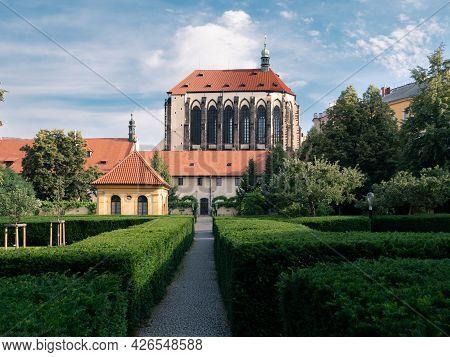 Franciscan Garden Or Frantiskanska Zahrada In Prague, Czech Republic With Church Of Our Lady Of The