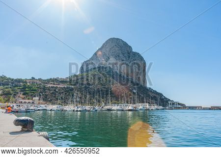 Calpe Spain - August 24 2016;rock Of Ifach, Large Rock Landmark With Marina Below In Coastal Tourist