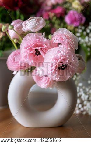 Tender Ranunculus Flowers In Trendy Ceramic Minimalistic Vase On Floral Background. Bunch Of Persian
