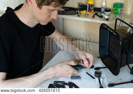 Chelyabinsk,chelyabinsk Oblast, Russia-june 20.2021 A Man Works With Electronics At The Table. A Man
