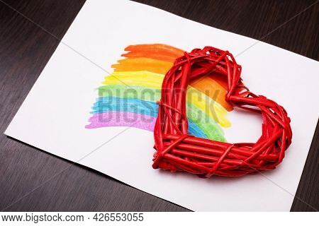 Painted Rainbow On A White Sheet Of Paper With Red Heart On Wooden Background. Lgbt (lesbian, Gay, B