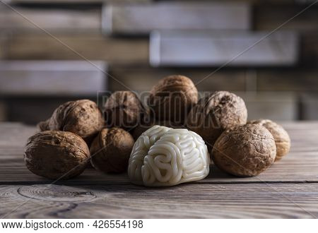 Walnuts Like Healthy Food For The Brain. Shape Of Human Brain Is Surrounded By Walnut Kernels. It Sy