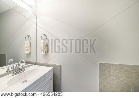 Modern Bathroom Vanity Sink With Stainless Fixtures