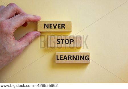 Never Stop Learning Symbol. Wooden Blocks With Concept Words Never Stop Learning. Beautiful White Ba