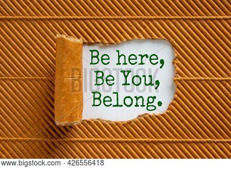 You Belong Here Symbol. Words Be Here, Be You, Belong Appearing Behind Torn Black Paper. Beautiful B