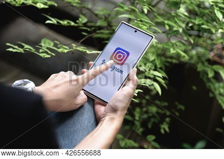 Chiangmai, Thailand - July 09, 2021: A Woman Holding Smartphone With Instagram Application On The Sc