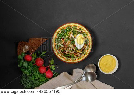 Russian Soup, Okroshka, With Ham, Egg, Cucumbers And Herbs. It Is Filled With Kvass, Kefir Or Minera