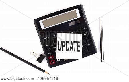 Update Text On Sticker On Calculator With Pen,pencil On White Background