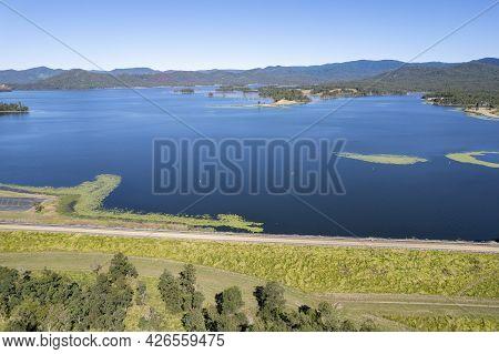 Aerial Over Rock Wall Towards The Water Catchment Area Teemburra Dam, Queensland, Australia