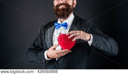 Forever Yours. 14th Of February. Handsome Man Making Proposal. Romantic Gift. Happy Tuxedo Man