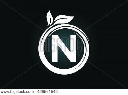 Initial N Monogram Letter Alphabet In A Spiral With Green Leaves. Font Emblem. Nature Icon Sign Symb