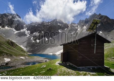 Apsoi Lake, Mountain Lake And Nearby Wooden Bivouac On The Path To Colle Delle Muine (pass Of Muine)