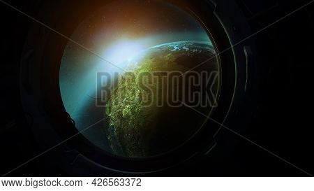View Of Planet Earth From The Porthole From Orbit.