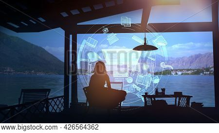Writer Working On A Laptop After Sunset.