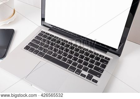 Modern Workspace, Mock Up Laptop Computer Blank White Screen, Eyeglasses And Smartphone White Table