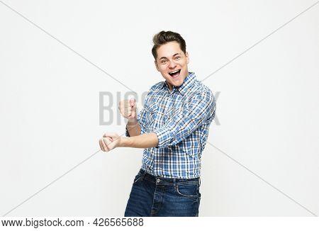 Portrait of triumphing handsome adult man chanting, celebrating success or achievement