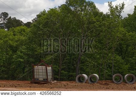 Concrete Tubes And Water Tank At A Road Construction Site In Georgia