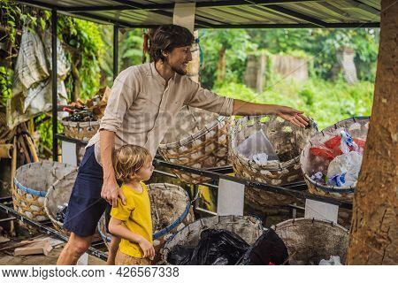 Dad And Son, Separate Garbage Collection. Teaching Children To Separate Garbage Collection