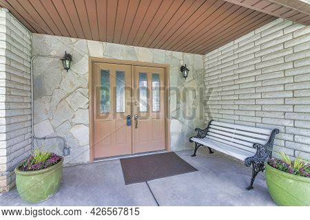 Glass Paned Double Front Door Of House With Modern Lockbox For Security