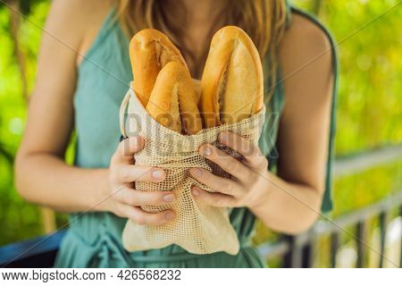 Reusable Grocery Bags With Bread In The Hands Of A Young Woman. Zero Waste Shopping. Zero Waste Conc