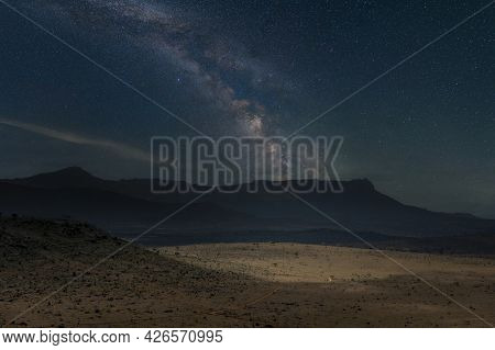 Beautiful Night Landscape With Stars, Hils And The Milky Way Galaxy. Beautiful Scene In Savanah