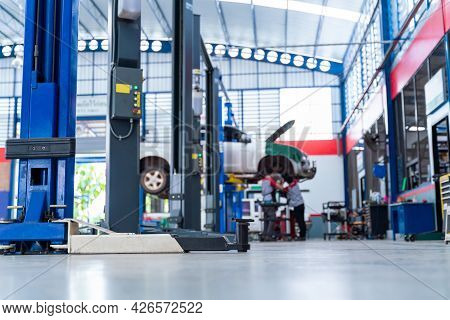 Select Focus Car Lift In Blurred Of Car Repair Service Centre Background