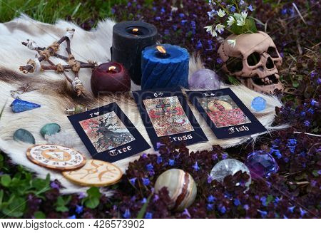Beltane Ritual With Tarot Cards, Skull, Burning Candles, Pentagram And Crystals Outside. Esoteric, G