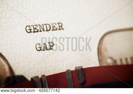 Gender gap phrase written with a typewriter.