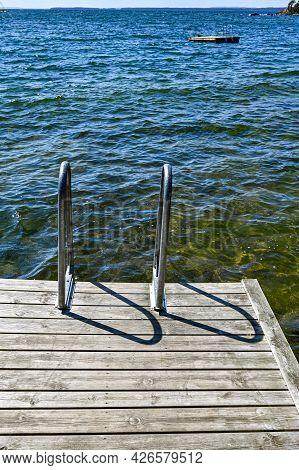 Jetty With Bathing Ladder In Lake Vattern Sweden