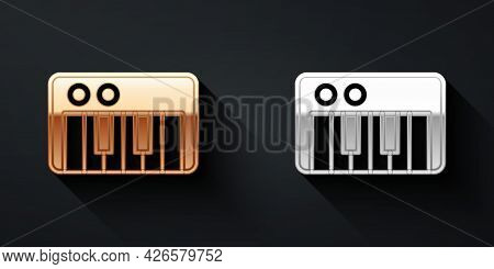 Gold And Silver Music Synthesizer Icon Isolated On Black Background. Electronic Piano. Long Shadow S